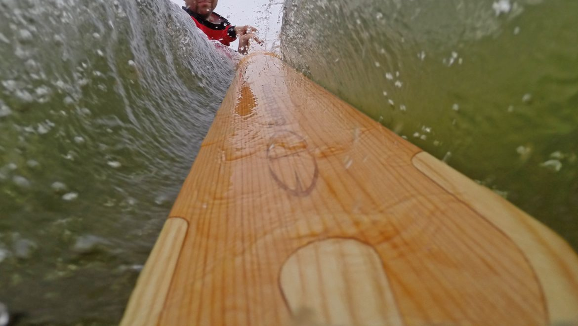 greenland paddle into the water